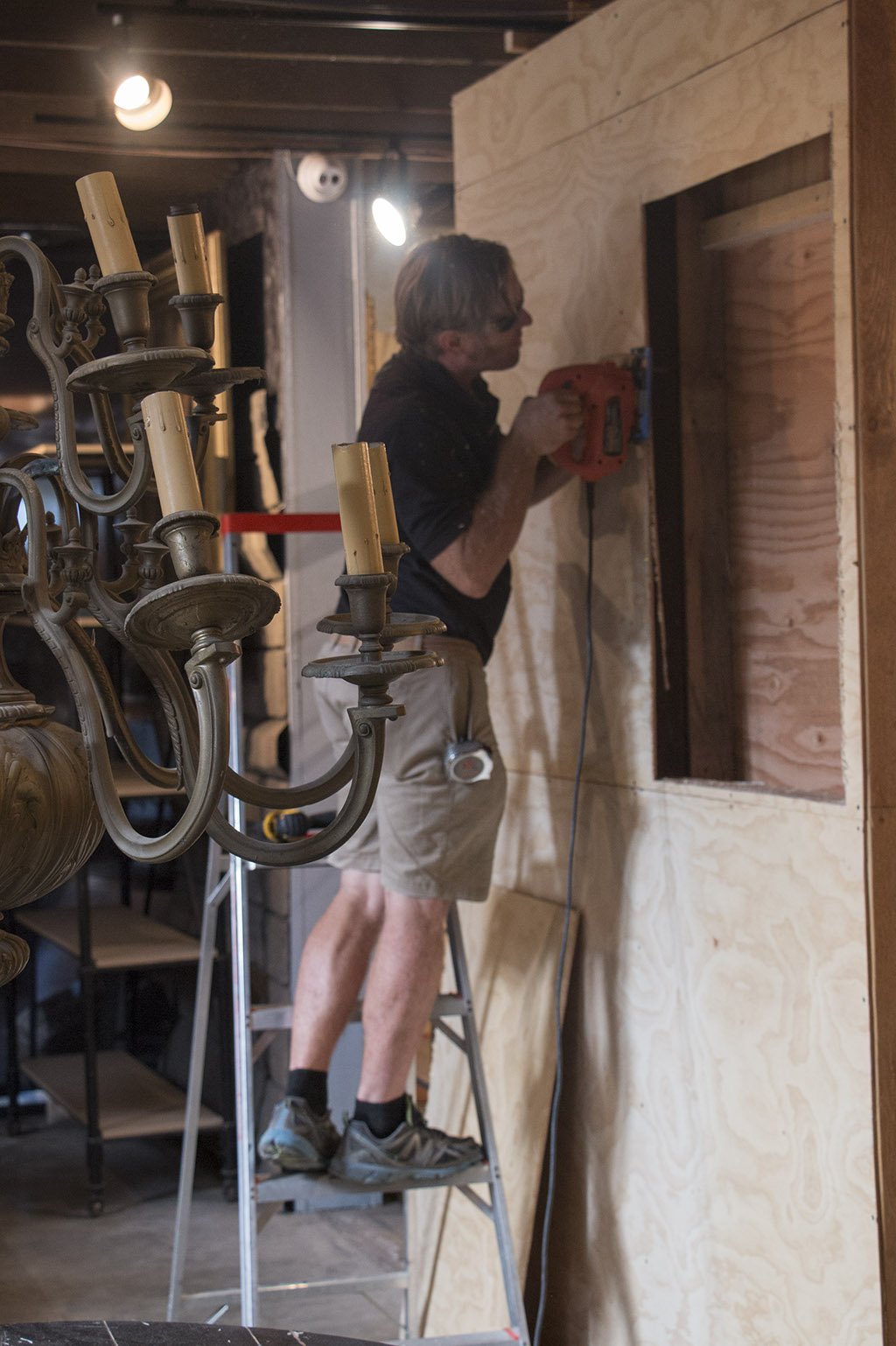 An image of one of the Roger's Gardens staff members building a Halloween set