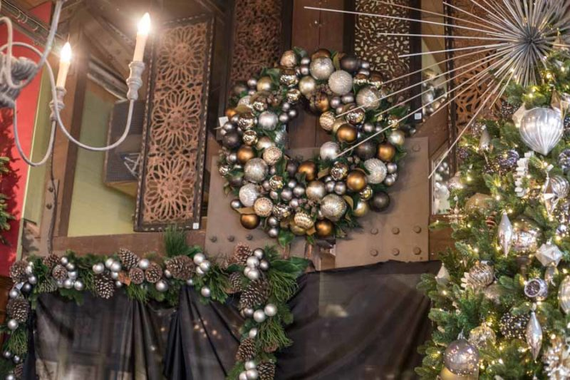 An image of golden silk Christmas wreaths made by the Original Designs team at Roger's Gardens