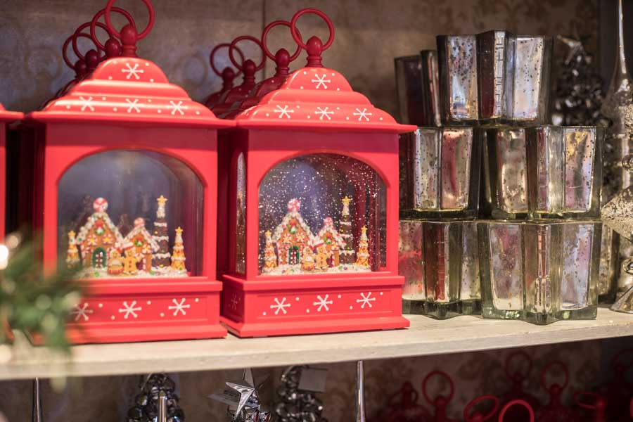 An image of gingerbread houses in a red decorative christmas lantern