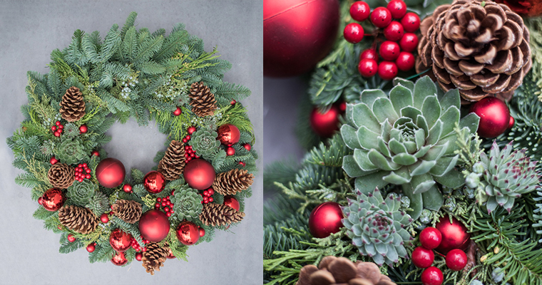 An image of fresh succulent, pinecone, red berry and red ball ornament wreath