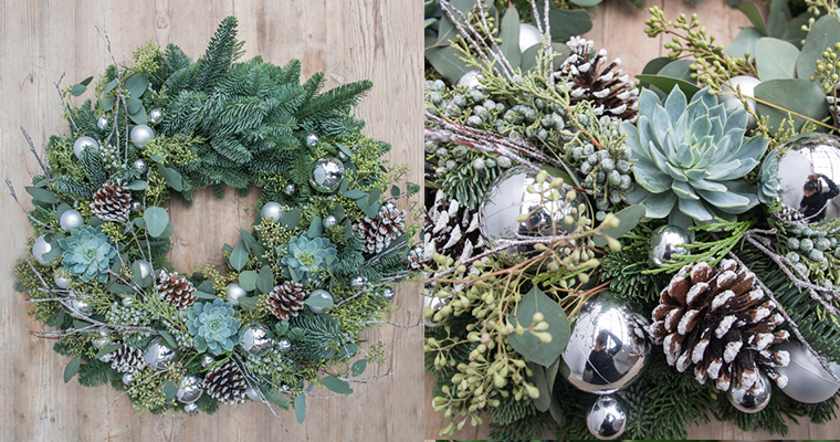 An image of silver ball ornaments, succulents and pinecone wreath
