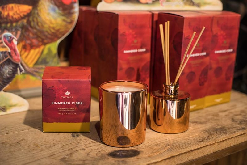 An image of Thymes Simmered Cider Candle and Essential Oils