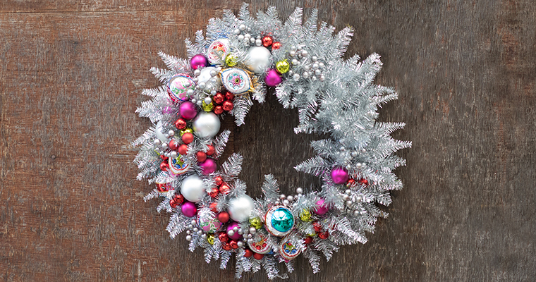 An image of pink, white, green, red, gold, and teal ornaments in a silver wreath for Shiny and Bright workshop