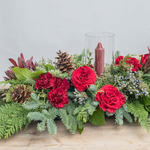 An image of a red rose and pinecone garland