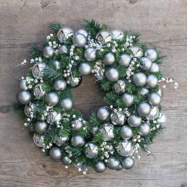 An image of a silver and blue ball ornament wreath