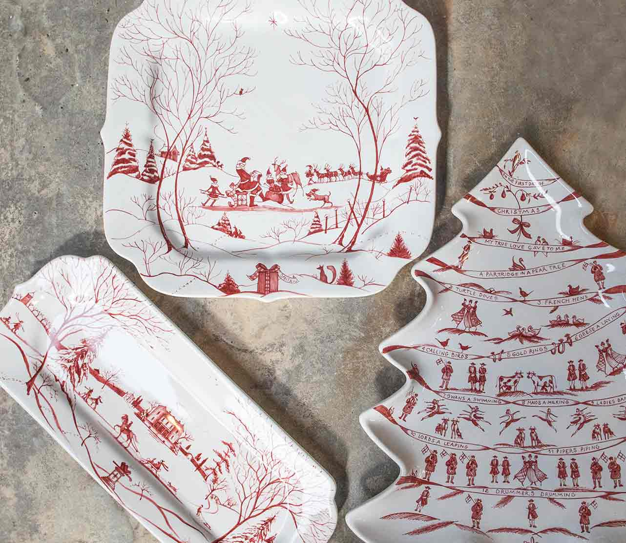 An image of red and white ceramic decorative Christmas Holiday Plates