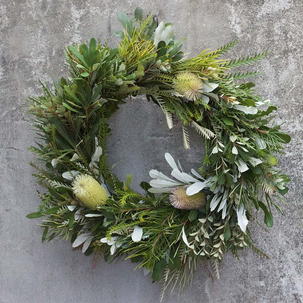 An image of a green leucadendron wreath