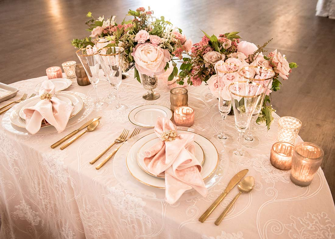 An image of a light pink dining set table for Fete Venue Wedding