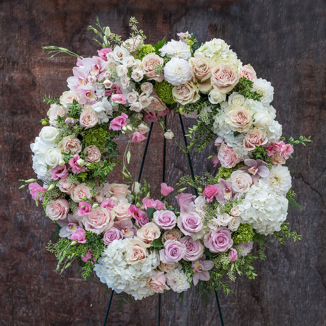 An image of a rose and hydrangea funeral wreath