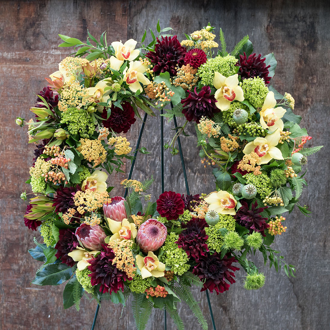 An image of a bright various flowered funeral wreath