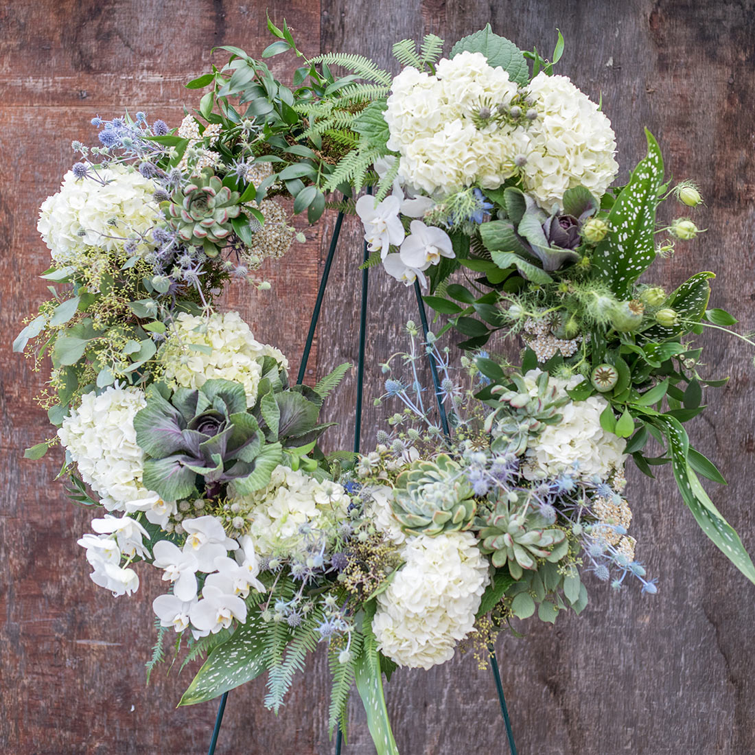 An image of white hydrangea funeral wreaths