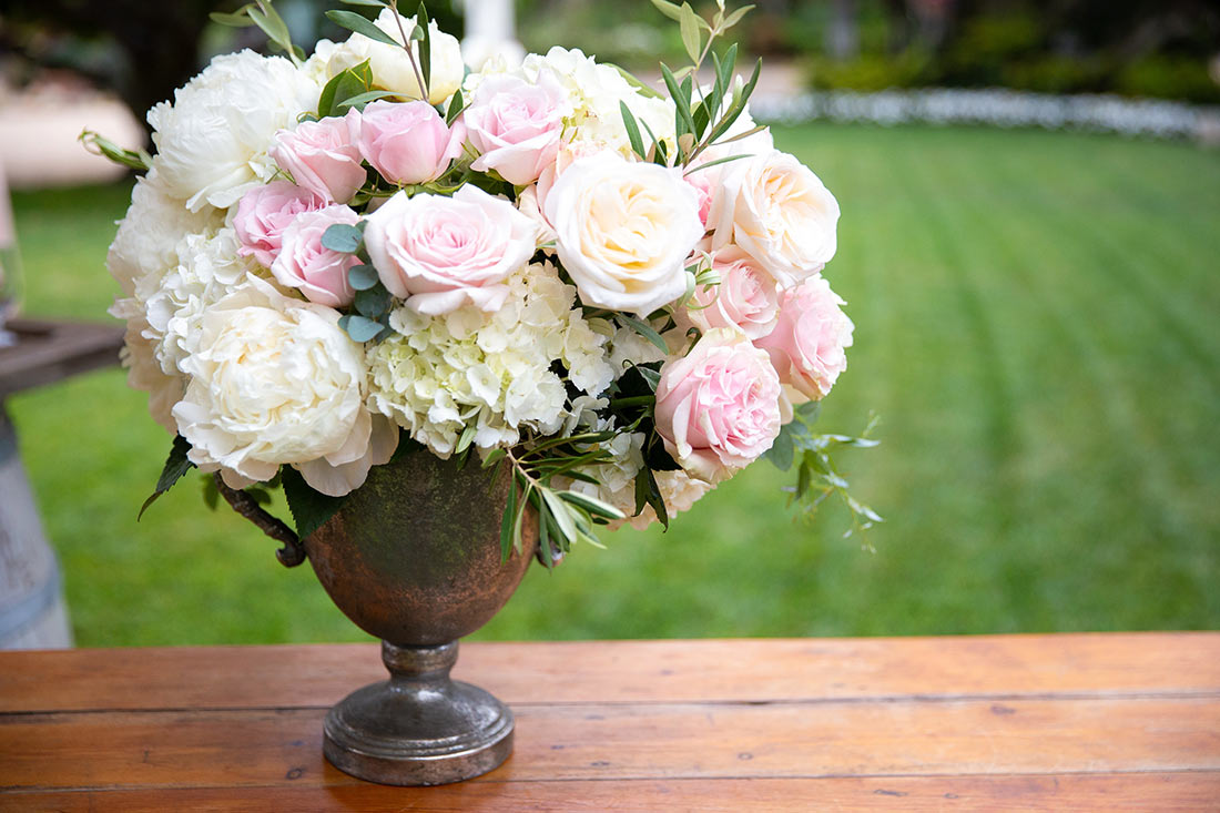 An image of pink and white roses as well as white hydrangeas floral arrangement