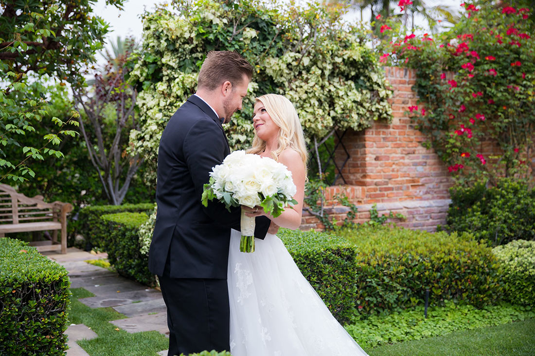An image of Mr. and Mrs. Herbert who is holding a large white rose bouquet