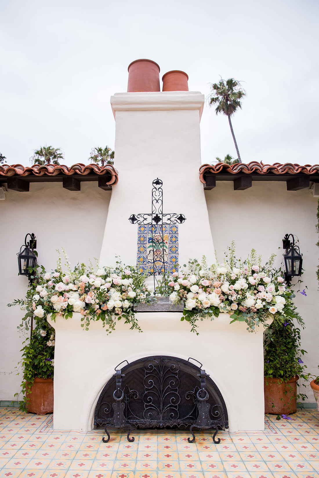An image of a floral decorated fireplace for the Herbert Wedding
