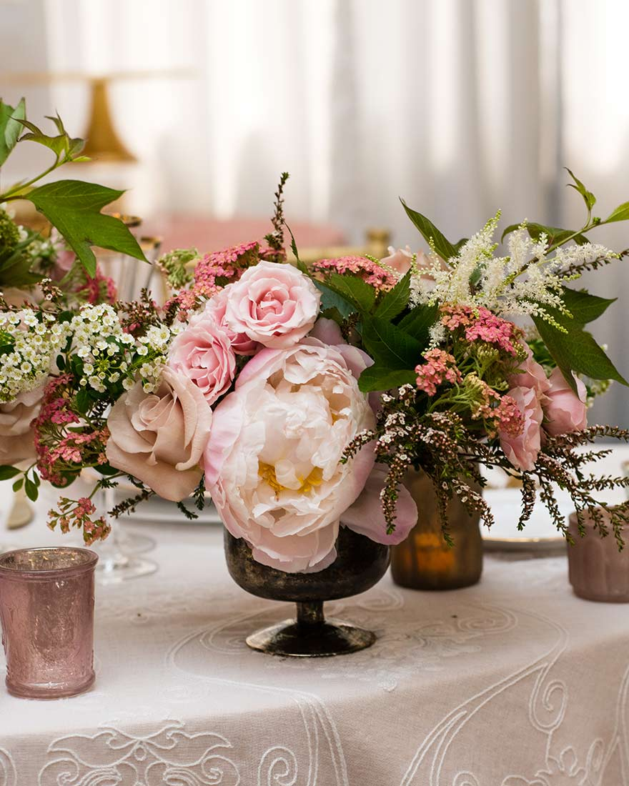 An image of a pink roses and white flowers floral wedding arrangement