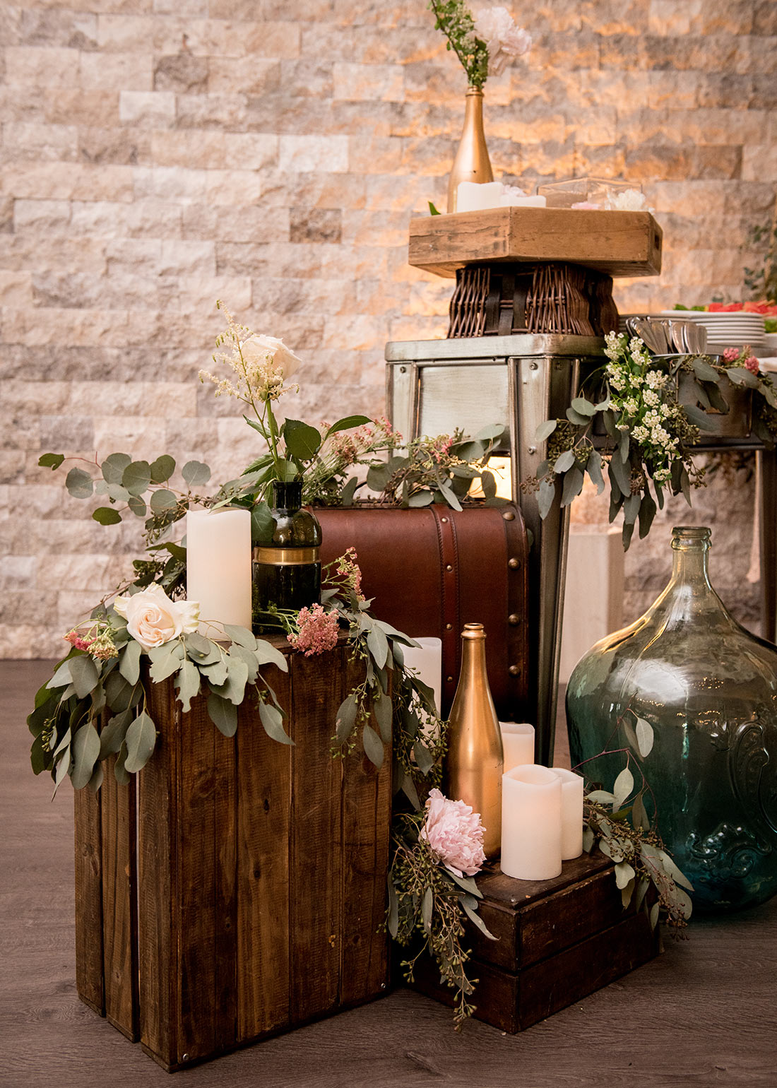 An image of the floral decorations decorating suits cases and vintage items for the Fete Venue Wedding