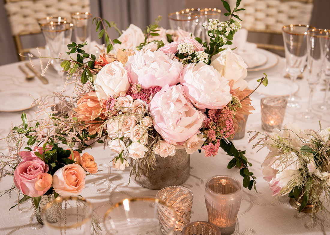An image of a floral wedding arrangement with light pink roses
