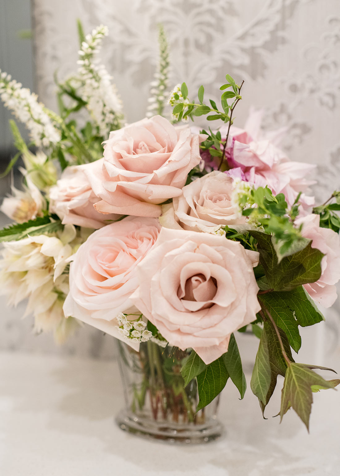 An image of light pink roses floral wedding arrangement with light pink roses