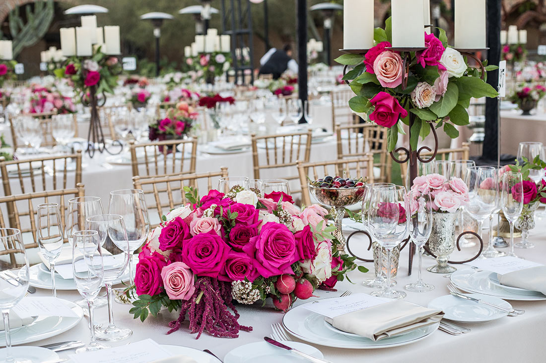 An image of a magenta, pink and white rose arrangement for the Mission San Juan Capistrano Gala