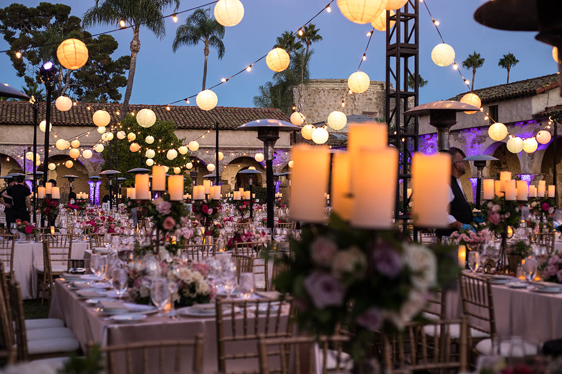 An image of all the decorated tables with candles and florals for the Mission San Juan Capistrano Gala