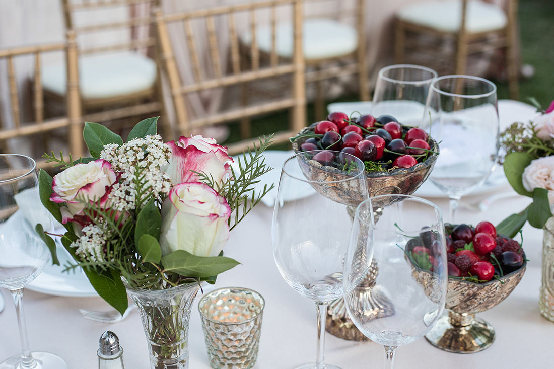 An image of a close up of the dining set up at the Mission San Juan Capistrano Gala