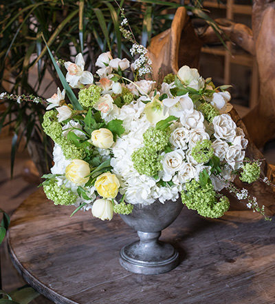 An image of white roses and hydrangeas floral arrangement