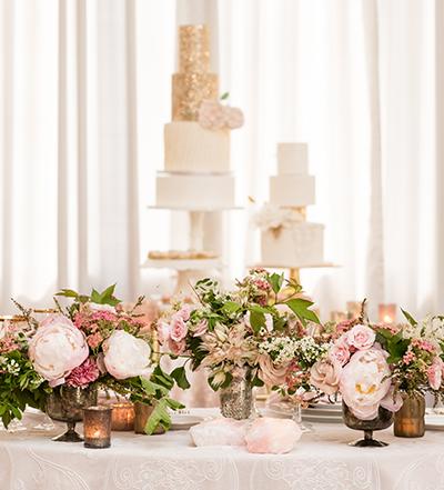 An image of light pink floral arrangements