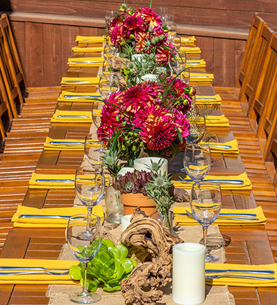 An image of a yellow theme pink red dahlia dining set up