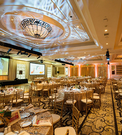 An image of the decorated white and gold tables for the Saddleback Memorial Care Gala