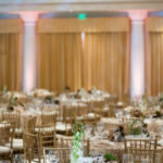 An image of the table showing the clear tall glass plant with driftwood table decorations for the Saddleback Memorial Care Gala