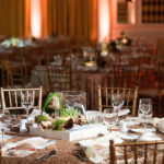 An image of a table decorated with a driftwood succulent center piece for the Saddleback Memorial Care Gala