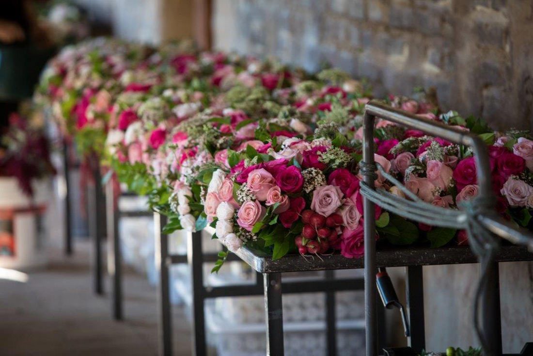 An image of the many light pink, pink and white rose florals for the Mission San Juan Capistrano Gala