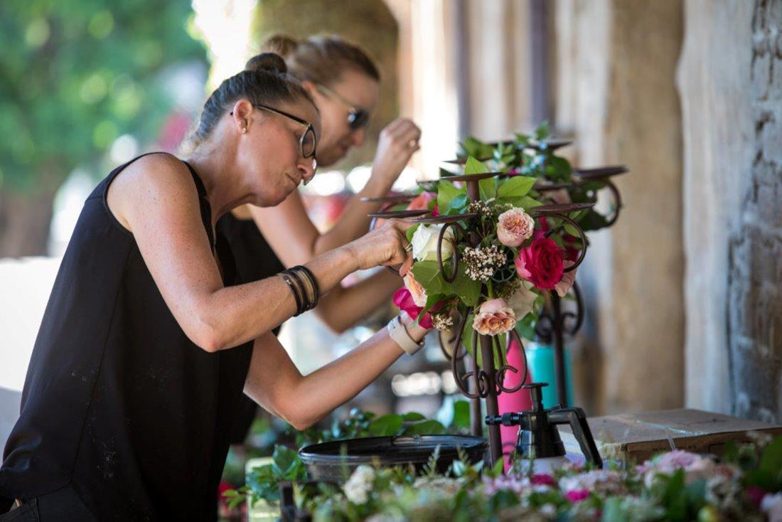 An image of Opal prepping the floral arrangement at the Mission San Juan Capistrano Gala