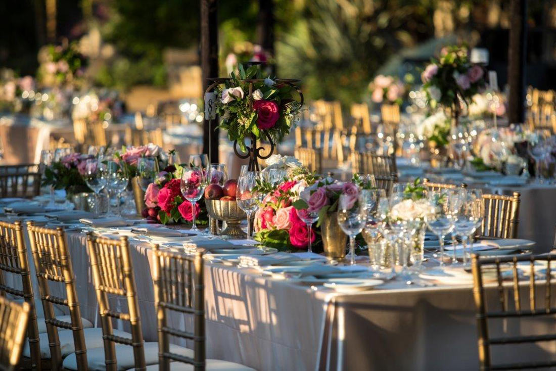 An image of the pink, light pink and white arrangement dining set up for the Mission San Juan Capistrano Gala
