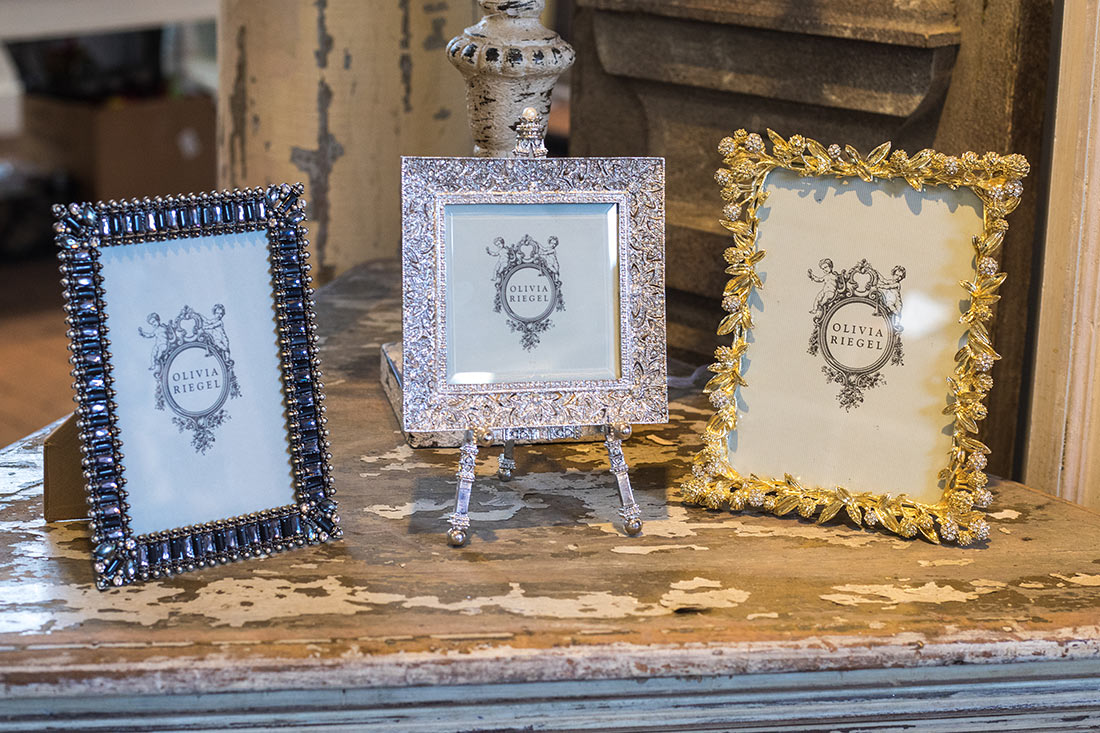 An image of jeweled decorated frames from Olivia Riegel