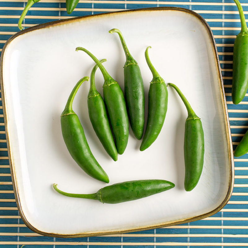 An image of green Serrano peppers