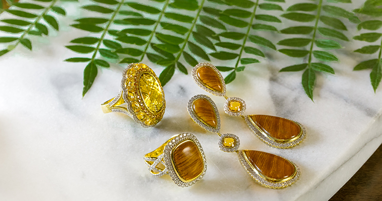 An image of yellow and wooden jewelry from Spring Collection of Gadbois Jewelry
