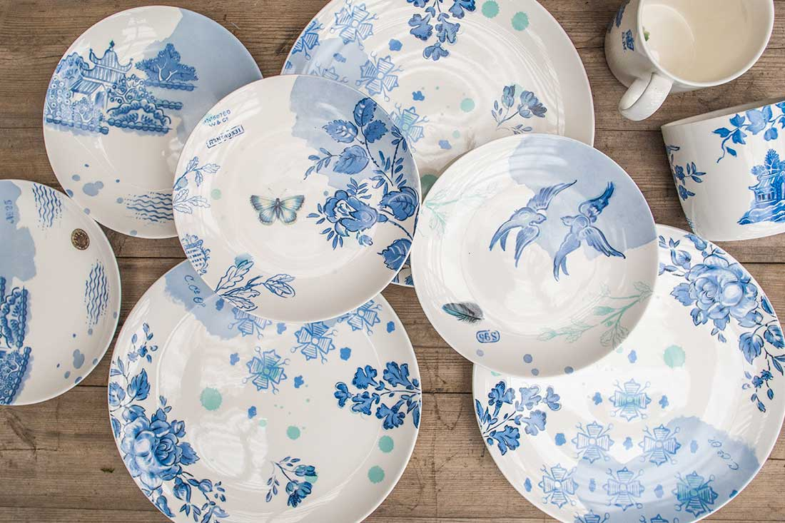 An image of blue & white stoneware plates decorated with butterflies, flowers and birds