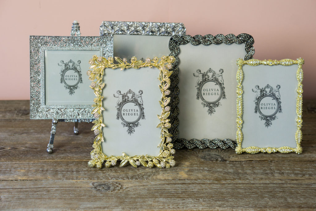 An image of gold, silver and black diamond studded frames from Olivia Riegel