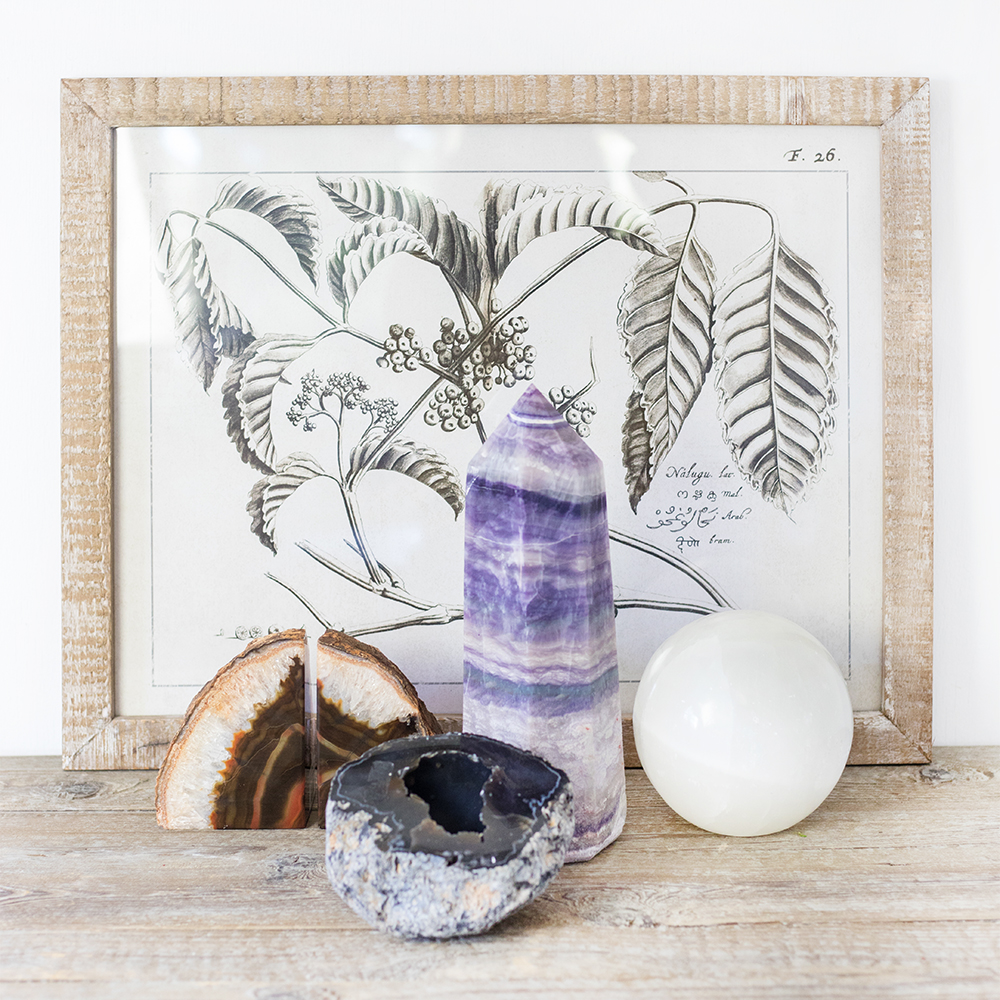 An image of an Amethyst, Agate and Selenite displayed in front of a decorative frame for Natural Beauty Home Decor