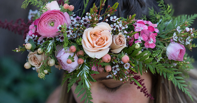 An image of a pink, orange, white and light pink flowers created in the workshop into a lovely, elegant flower crown
