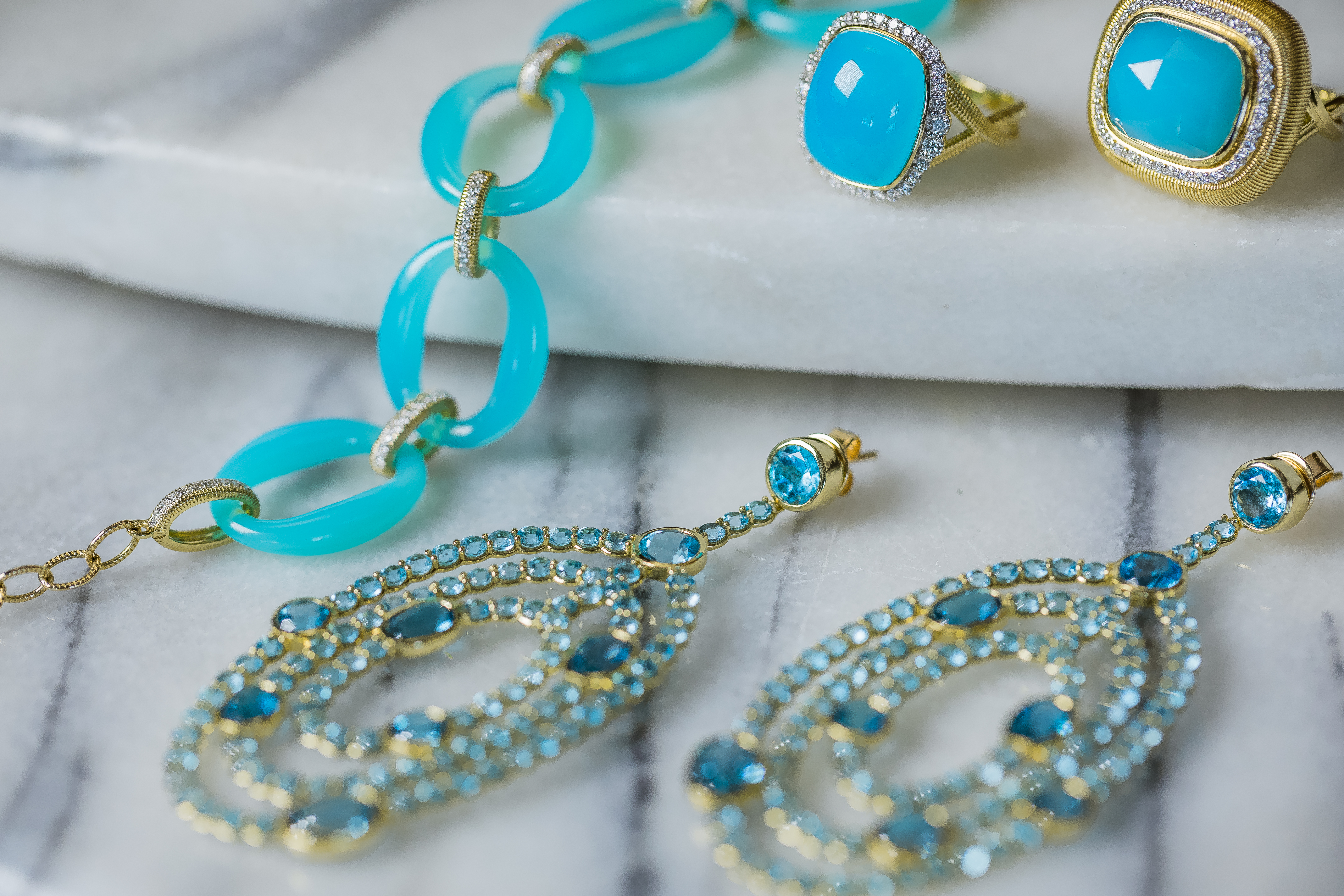 """An image of aqua blue topaz gold jewelry from the Gadbois Glory """"Spring Vibe"""""""