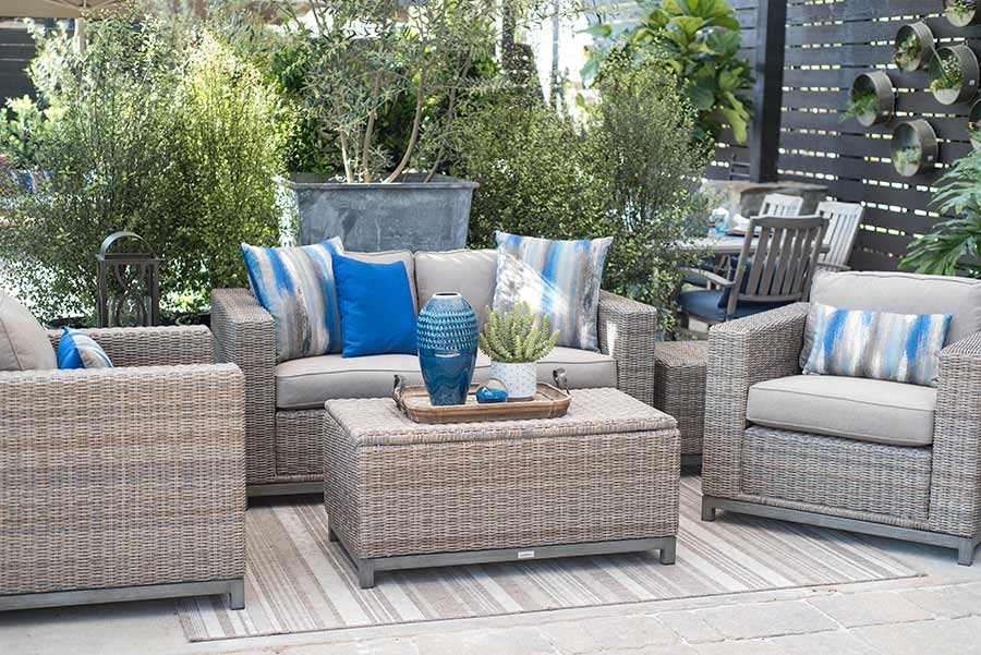 An image of the Skycrest Loveseat Outdoor Set with blue, grey and white pillows