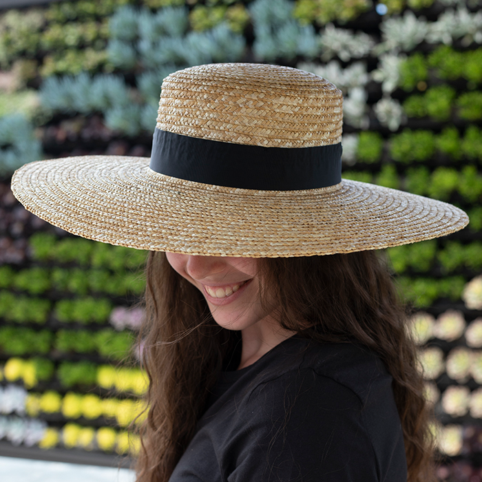 An image of a large straw hat with a black ribbon
