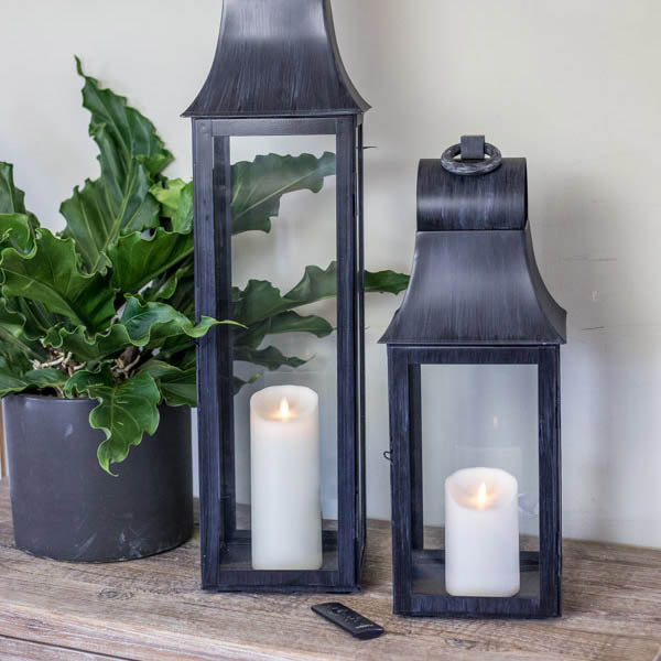 An image of black paired outdoor lanterns